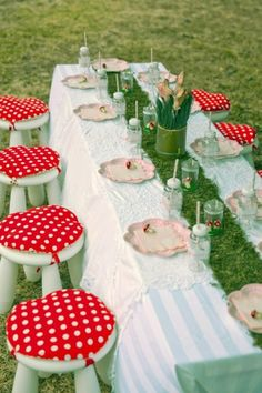 Mushroom/woodland party, i love the ikea white kid stools and red polka dot cushions!!