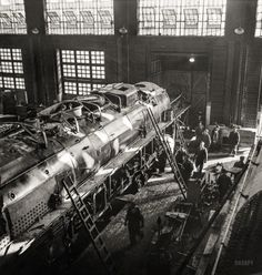"""December 1942. """"Working on a giant locomotive, one of the '400s,' in the Chicago & North Western Railroad shops."""""""