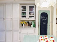 maybe do pantry door in a different color distressed like this & paint the panels with chalk board paint as planned