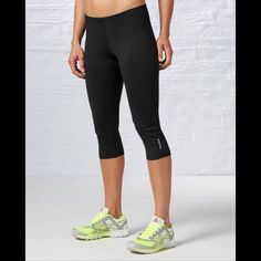Women Running Essentials Capri READY FOR A WORKOUT Polyester and Spandex fabrication for a light, soft and stretchy feel Fitted - contours to the body, won't slow down high-impact exercise PlayDry technology wicks sweat to help keep skin dry and comfortab