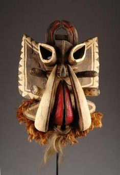 Africa   Mask from the Ngere people of the Ivory Coast   Wood, paint, metal, animal fur, board tusks, rifled antelope horns, buffalo horns