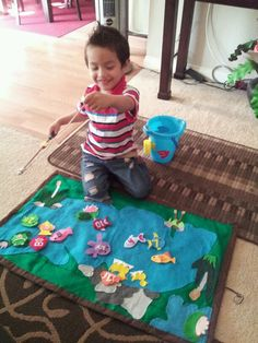 Diy felt fishing game complete with fishing pole and bucket. It folds up real small so very portable.used magnet on fishing pole and paper clips inside fish topped it off with hot glue gun. Fishing game felt pkaymat play mat