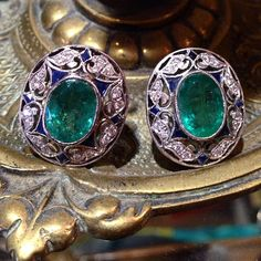 Platinum emerald, sapphire, and diamond earrrings at The Antique Guild of Alex, Va.