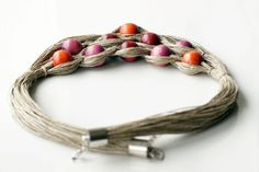 This necklace is made of wooden colourful beads and natural linen. The linen is fitted into the brass end in oxidized silver tone with metal jump rings and the copper lobster clasp. An non-allergic (nickel and lead free) metal extender is added to this necklace so you will be able to adjust a length. It is chunky but because of nicely combined soft colours it also looks elegant and stylish. It would definitely add a special flare to your outfit. The necklace is very eye-catching…