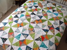So bright and lovely: Kaleidoscope quilt. The solid white make the prints stand-out.
