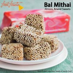 Have you tasted Anand Sweets' Bal Mithai yet? If not, order now, in India, on FoodFeasta. Almora's preferred delicacy, at the comfort of your home. #BalMithai is a brown chocolate-like fudge, made with roasted khoya, coated with white sugar balls, and is a popular sweet from the Himalayan state of #Uttarakhand in India, especially regions around #Almora. Its chief ingredients mainly consists of khoya, cane sugar, sugar, etc. Indian Desserts, Indian Sweets, Indian Snacks, Indian Dishes, Quick Recipes, Sweet Recipes, Fudge, The Best, Sweet Tooth