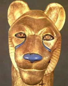 Lion's head, forming the sides of a bed, made of wood, overlaid with gold with glass nose and eyes.