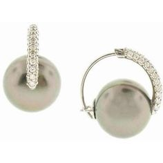 These earrings are comfortable and understated huggies with Tahitian Peacock Pearls.  From Beverly Hills Designer Atelier Marissa.  She wrote the book on Tahitian Pearls