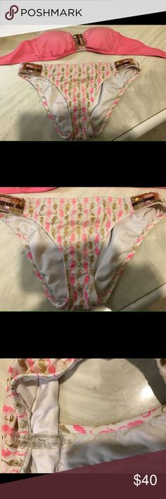 Womans Victoria Secret Bathing Suit It is a womans 2 piece, the bottoms are a size medium & the top is a size small. The bottoms are white with sea horses on them, in mint condition!! And the top is a little faded, color is pink. Both for 40! PINK Victoria's Secret Swim