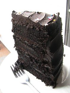 "Previous Pinner wrote, ""Hershey's Decadent Dark Chocolate Cake - 10 Stars!  If you are looking for a chocolate recipe for Valentine's Day - look no further!  This is an old Hershey's Chocolate recipe - I know this is my Grandmother and my Mom's old recipe.  The twist is using the new powdered Dark Chocolate cocoa.  This is one of the most MOIST cakes you will ever make.  It is critical to use boiling hot water - do not miss this step."""