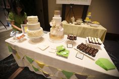Beautiful example of what a dessert table at your #VegasWedding could look like by Peridots Sweets. We're obsessed with the pretty #gold details on that center cake! #VegasPWGShow #Vegasbride #weddingcake  #desserttable