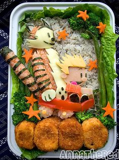 Bento box lunch of Calvin and Hobbes.  I can't even draw this on paper and people are making this with rice and cheese.  Damn they're good.