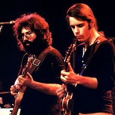 Jerry Garcia and Bob Weir of the Grateful Dead performing in 1972.: