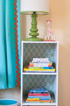 two ideas I love - embellishing pre-made curtains and putting paper or fabric in the back of white shelves.