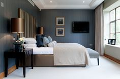 Art Deco inspired guest bedroom in 1930's refurbished apartment designed by www.aji.co.uk with bronze and blue accents