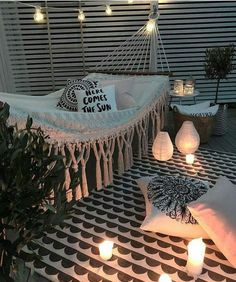 Outdoor living outdoor style hammock porch outdoor lights lanterns rope lights deck rustic modern home decor diy decor diy home decor apartment living rooftop outdoors rug lights here comes the sun pillow cozy hangout outdoor entertainment