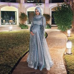 Image may contain: 1 person, standing and outdoor Indian Maternity Wear, Maternity Gowns, Maternity Fashion, Abaya Fashion, Muslim Fashion, The Dress, Baby Dress, Dress Flower, Hijab Dress Party