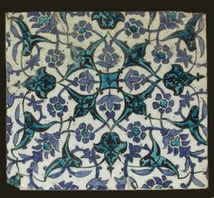 Damascus Tile    A stone paste tile, the white ground painted in cobalt-blue, black and turquoise with a lattice of split-leaves palmettes and arabesques overlaid by a similar arrangement of flower-heads and palmette vine.    Syria, Damascus, late 16th century, 29 cm by 25.5 cm.