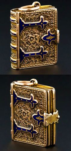 For the love of Books...Antique Victorian Book Locket, from the mid-1880′s, made of engraved 14k gold and blue enamel. It was sold by Lang Antiques.