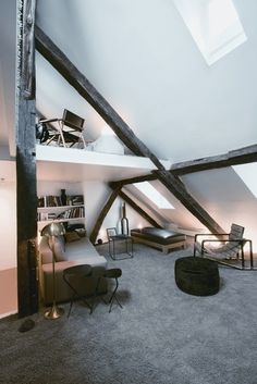 love white  love dark beams  love attic spaces   this room as CKN written all over it.  (my bedroom growing up was large attic space)