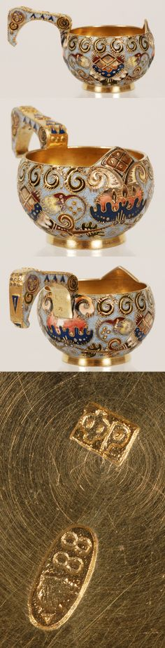 A Russian silver and shaded cloisonne enamel kovsh by Feodor RUckert, Moscow, circa 1908-1917. Of traditional oval form with a hook handle, the body covered with Pan-Slavic style enamel in blue and gray hues.