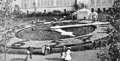 The great Floral Clock, 112 feet in diameter, was a popular exhibit on a hillside near the Palace of Agriculture. The thousands of flowering plants on the clock's face were 'timed' to bloom throughout the passing of the day's hours. The tip of the 74-foot long minute hand moved 6 feet every minute. The 1904 World's Fair Society owns the clock's master works, which is presently on display at the History Museum in Forest Park.