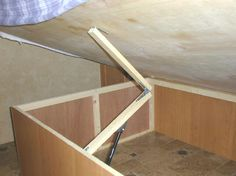 How to change out the hydraulic cylinder that holds up the bed to access under the bed storage. This site has so many ideas, complete with pictures and info, to increase storage in your camper. GREAT SITE!!