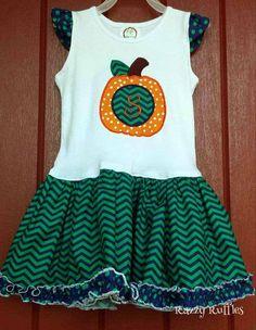 A cute pumpkin dress with your pumpkin's initial. https://www.etsy.com/shop/RazzyRuffles