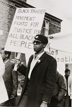 """Black Panther Movement Fights for Justice for All Black People"" Young men of the Black Panther movement march in support of black community, 1971. Photo credit: Neil Kenlock"