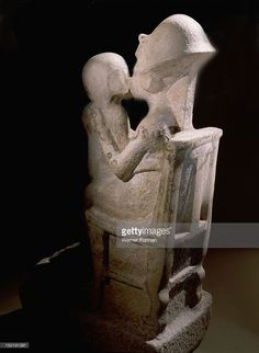 Akhenaton kisses his daughter as she sits on his lap, An unfinished statue. Egypt. Ancient Egyptian. Amarna period c 1373 1357 BC. Tell el Amarna.