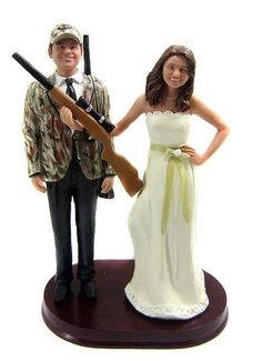 This is the most realistic camo I have found on a cake topper. This company will even use pics of yourself and your betrothed to make the bride and groom look just like you! I LOVE it! BobbleGr.am - Hunting Bride and Groom w/ Shotguns Cake Topper, $184.99 (http://www.bobblegr.am/hunting-bride-and-groom-w-shotguns-cake-topper/)