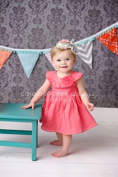 Caralee Case Photography. Baby and Child Photographer. Coral Dress. 1st birthday pictures.