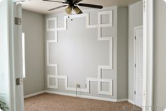 DIY Greek Key Molding Tutorial I think this would look pretty cool smaller and repeated like wainscoting with a plain chair rail on top. Faux Wainscoting, Wainscoting Bedroom, Dining Room Wainscoting, Wainscoting Styles, Wainscoting Height, Wall Molding, Moldings, Diy Molding, Focal Wall