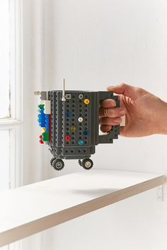 Put wheels on your Lego mug!!! Love this! :: ThinkGeek Build-On Brick Mug