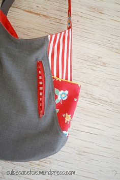 241 tote with two side pockets and one exterior slash pocket