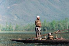 On a lake, a Muslim prays on his Shekara boat, Srinagar, Kashmir. (A.Abbas)