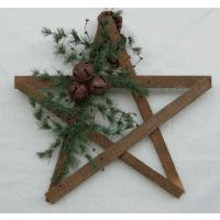 "Make this star out of ""aged"" paint stirrers.  Add some greens and rusted jingle bells for extra texture."