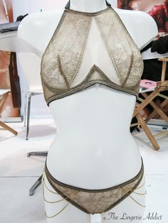 This burnished gold lace and mesh bra has a wonderfully innovative silhouette. By Edge O'Beyond