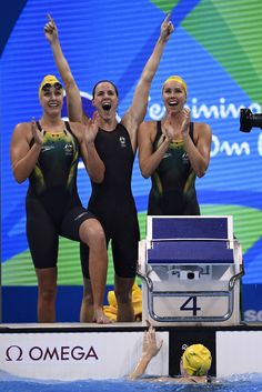 (FromL) Australia's Brittany Elmslie, Australia's Emma Mckeon and Australia's Bronte Campbell and Australia's Cate Campbell celebrate after they broke the world record to win the Women's 4x100m Freestyle Relay Final during the swimming event at the Rio 2016 Olympic Games at the Olympic Aquatics Stadium in Rio de Janeiro on August 6, 2016.   / AFP / Martin BUREAU