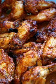 Spicy Chicken Wings...allow 30 min baking time before adding sauce, then another 15 min. in oven. Uses Heinz 57 sauce, etc.