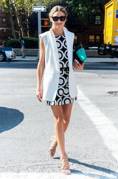 Olivia Palermo in a mod-inspired black and white Desigual dress, long vest, and Aquazurra heels.