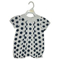 100% cotton all in one in white with navy spots.  www.violetagnes.co.uk
