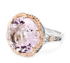 Brighten your day with this budding Rose Amethyst rosette ring. 18k rose gold details shine warm against a slender .925 silver sculpted crescent frame for a show stopper in full bloom.