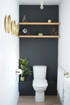 Dark grey downstairs bathroom diy home makeover with shelves in the alcoves and gold accents plus faux succulents and plants. Dark grey downstairs bathroom diy home makeover with shelves in the alcoves and gold accents plus faux succulents and plants. Small Downstairs Toilet, Small Toilet Room, Downstairs Cloakroom, Small Bathroom, Bathroom Ideas, Small Toilet Decor, Small Toilet Design, Dark Gray Bathroom, Remodled Bathrooms