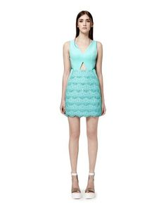 b49f582f5ee A refreshingly feminine dress crafted from intricate spearmint lace