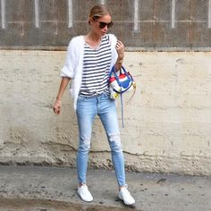 Anine Bing in the perfect San Francisco outfit - a striped tee, fuzzy white cardigan ripped skinny jeans, white sneakers and a statement bag