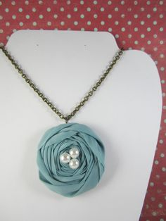 Fabric rosette necklace. For similar designs or custom creations view my shop trinketsbycrystal.etsy.com