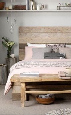 Wooden panelling against a dusted pink duvet counterbalance eachother to create a calming bedroom you can relax in. Use decor in natural fibers to create a home where you can easily unwind.