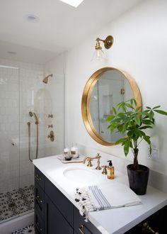 Beach Style Bathroom by Holst Brothers General Contractors