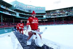 Jake Oettinger Photos Photos - Jake Oettinger of the Boston University Terriers leads his team onto the ice before their game against the Massachusetts Minutemen at Fenway Park on January 2017 in Boston, Massachusetts. In Boston, Boston Red Sox, Boston University Terriers, January 8, Buster Posey, Tampa Bay Rays, Fenway Park, Boston Massachusetts, Derek Jeter